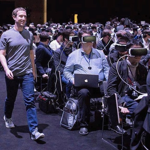 Image of Mark Zuckerberg in a room full of people using Augmented Reality (AR) glasses