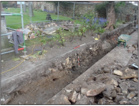 Plate 2: View of foundation trench with rubble features from the south west.