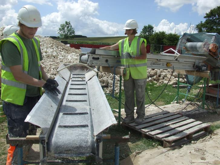 Progress shot of work on the conveyor-searching for finds through the chalk ©English Heritage