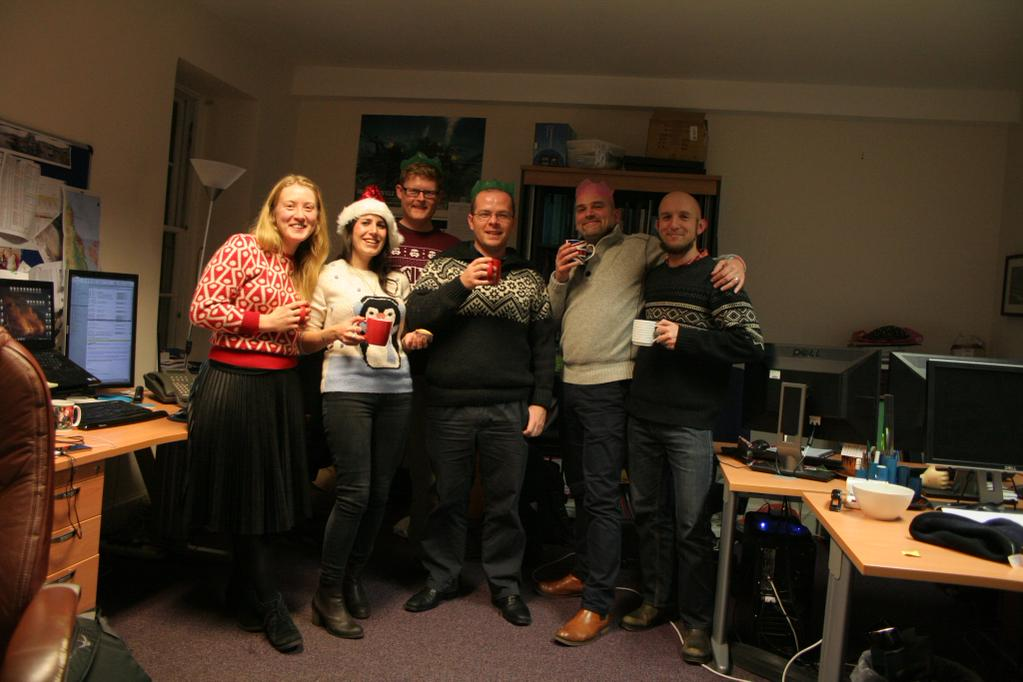 A dig team at a christmas party. Competition winning image.