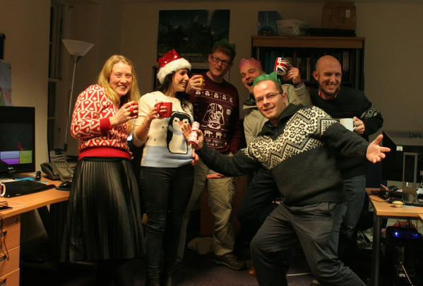 Another image of the dig team at a christmas party. Competition winning image.
