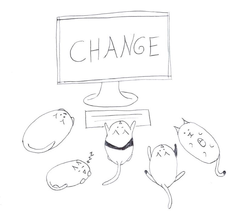 "Five cats sit around a computer monitor that reads ""CHANGE.""  Two of the cats are attentive, one is typing on the keyboard, one is playing with a mouse, and the fifth is asleep."
