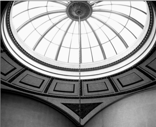 Black and white photo showing a detail of a domed glass ceiling at Chatsworth House