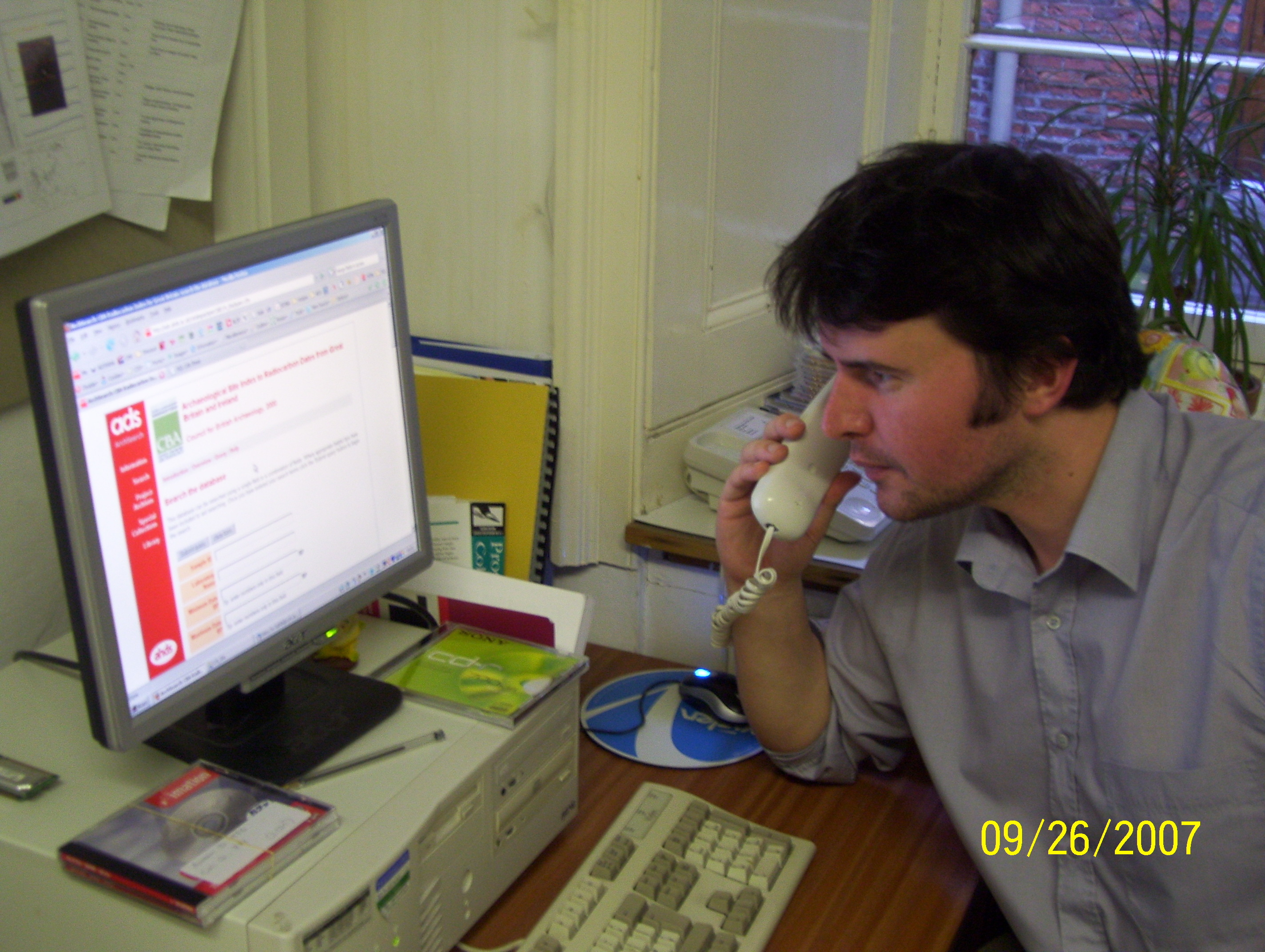 Image of Tim Evans answering the phone