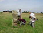 Checking a standing stone for carvings